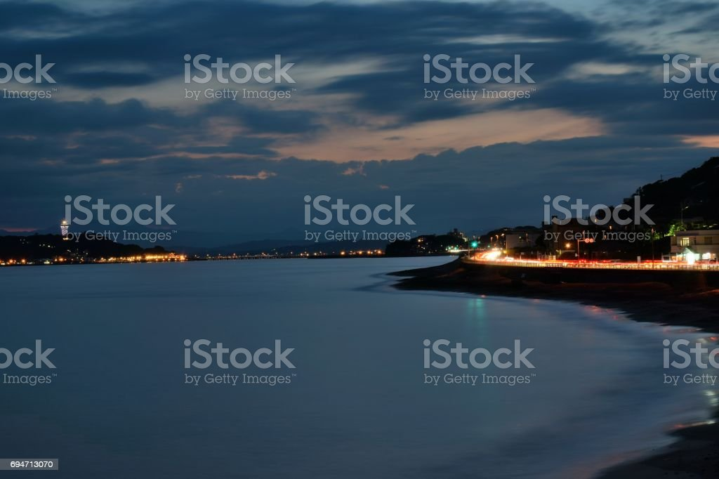 Landscape of Enoshima island in Japan at night with moving light trails stock photo