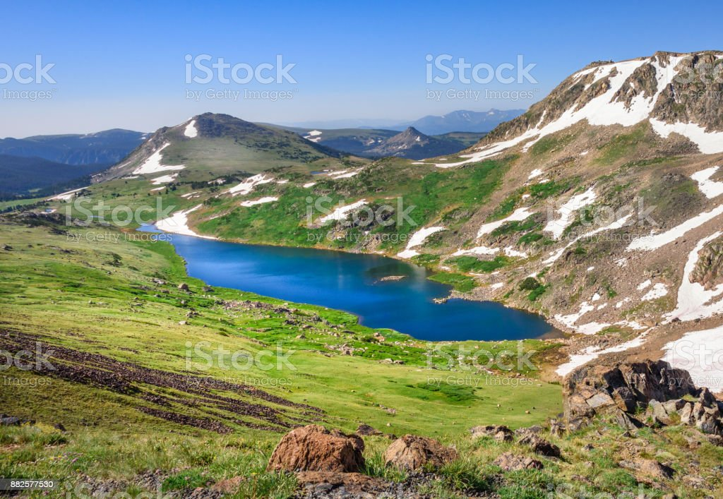 Landscape of Gardner Lake, Beartooth Pass. Peaks of Beartooth Mountains, Shoshone National Forest, Wyoming, USA. stock photo