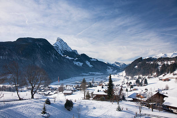 Landscape of Gstaad in Switzerland, with snow in winter stock photo