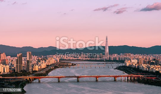 landscape of han river in seoul. modern business buldings and apartment in seoul on sunset