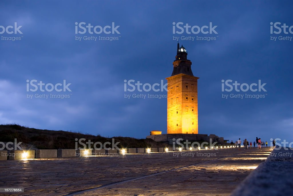 Landscape of Hercules Tower illuminated at dusk stock photo