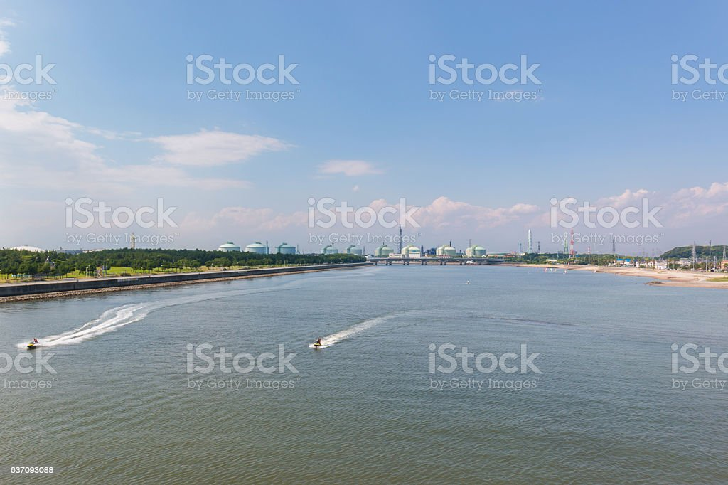 Landscape of industry at port with jet ski on sea stock photo