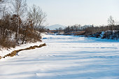 Landscape of lake covering with snow.