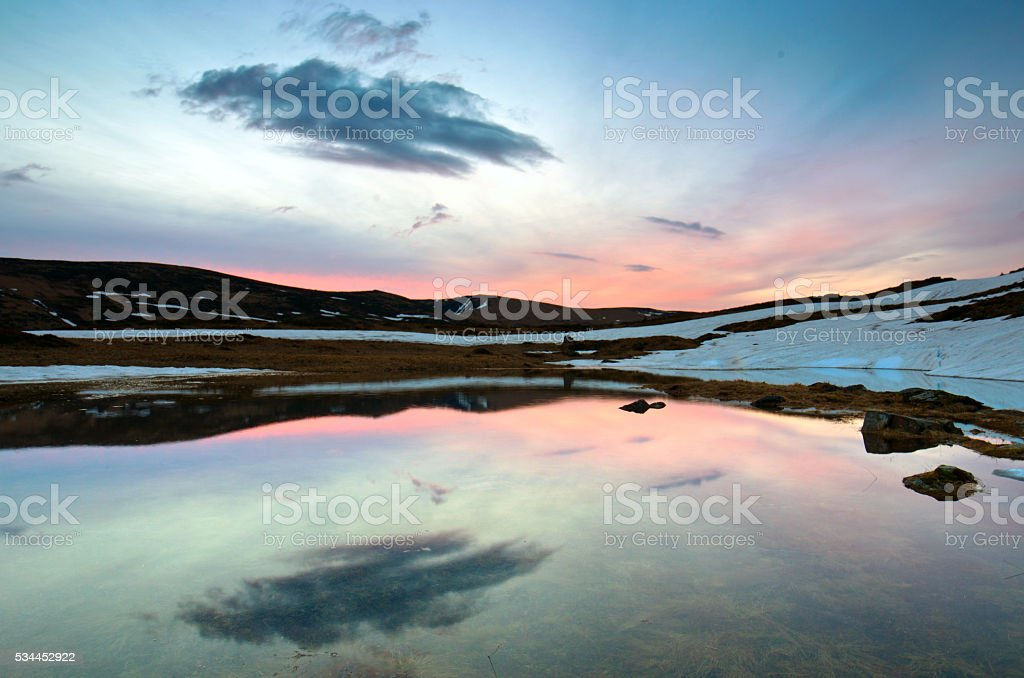 Landscape of lake with transparent water and distant mountains r stock photo