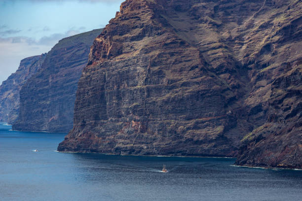 Landscape of Los Gigantes cliffs in Tenerife seen from a beach. Canary Islands, Spain stock photo