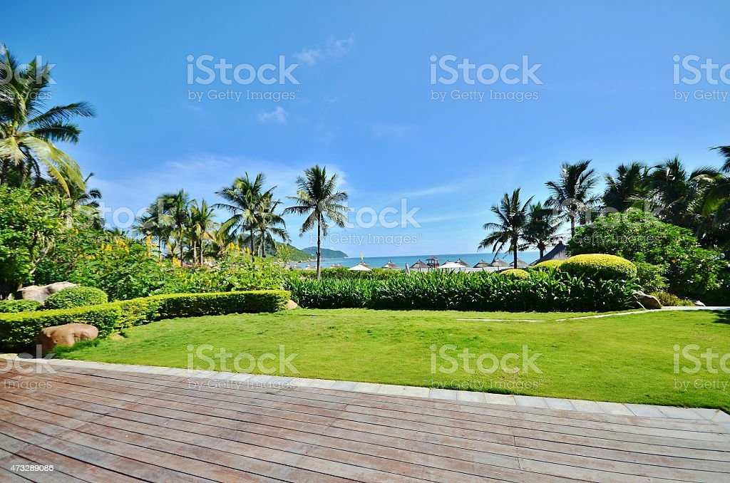 Landscape of manicured lawns and shrubs at a beach resort stock photo