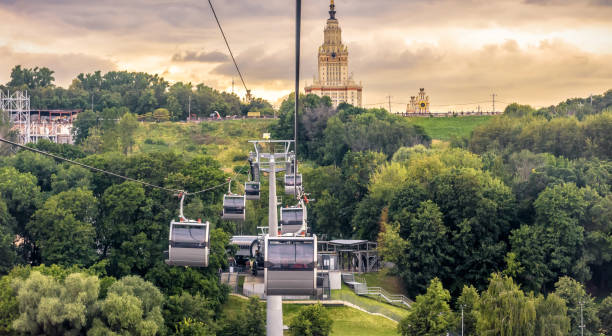 Landscape of Moscow at sunset, Russia. Scenic panoramic view of cable car and Moscow State University on Sparrow Hills. stock photo