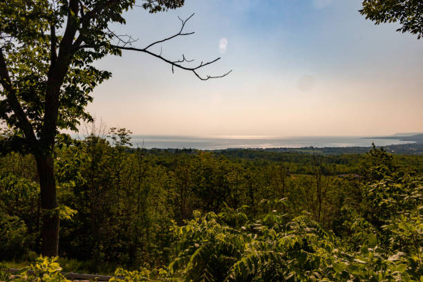landscape of Niagara Escarpment and Georgian Bay, with Blue Mountain ski slopes, Collingwood and Meaford Marina in the background stock photo