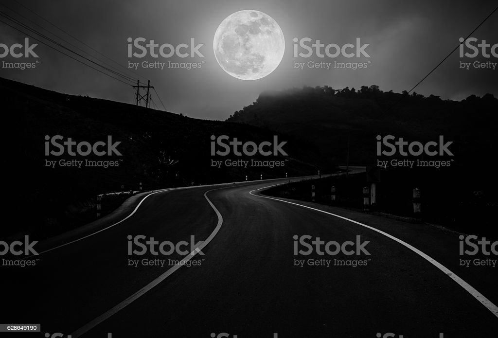Landscape of nighttime with curvy roadway in forest at national stock photo