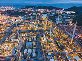 Landscape of Oil and Gas Refinery Manufacturing Plant., Petrochemical or Chemical Distillation Process Buildings., Factory of Power and Energy Industrial at Twilight Sunset, Engineering Petroleum