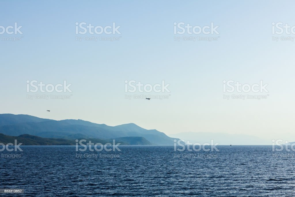 Landscape of open sea with islands in background stock photo