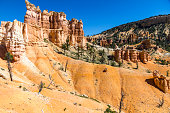 Landscape of red hoodoos in Bryce Canyon on a trail