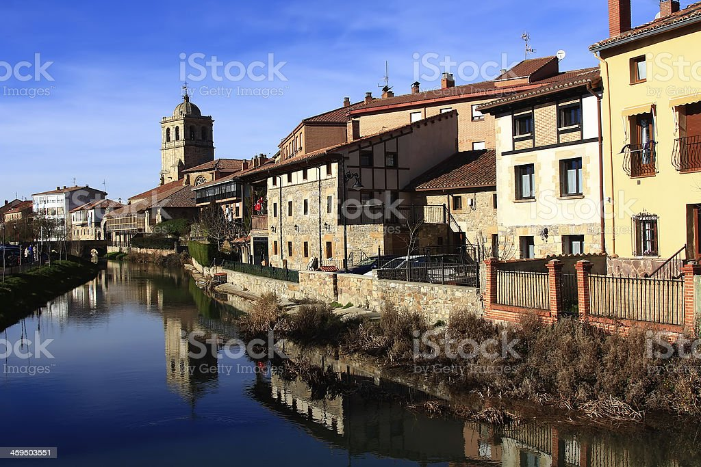 Landscape of river and village in Aguilar de Campo stock photo
