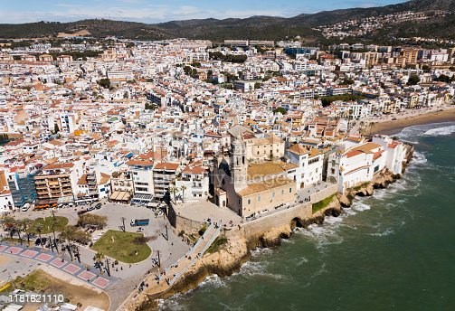 Landscape of picturesque Spanish town of Sitges with Monastery on Mediterranean seaside