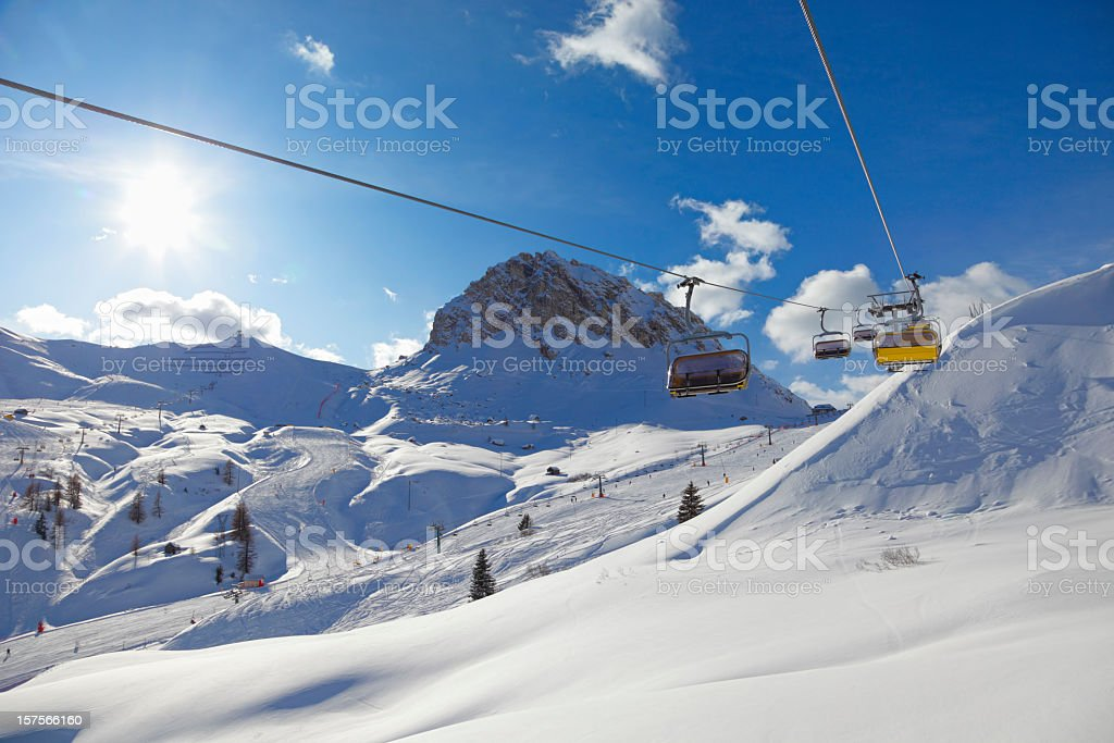 A landscape of ski slopes during the day stock photo