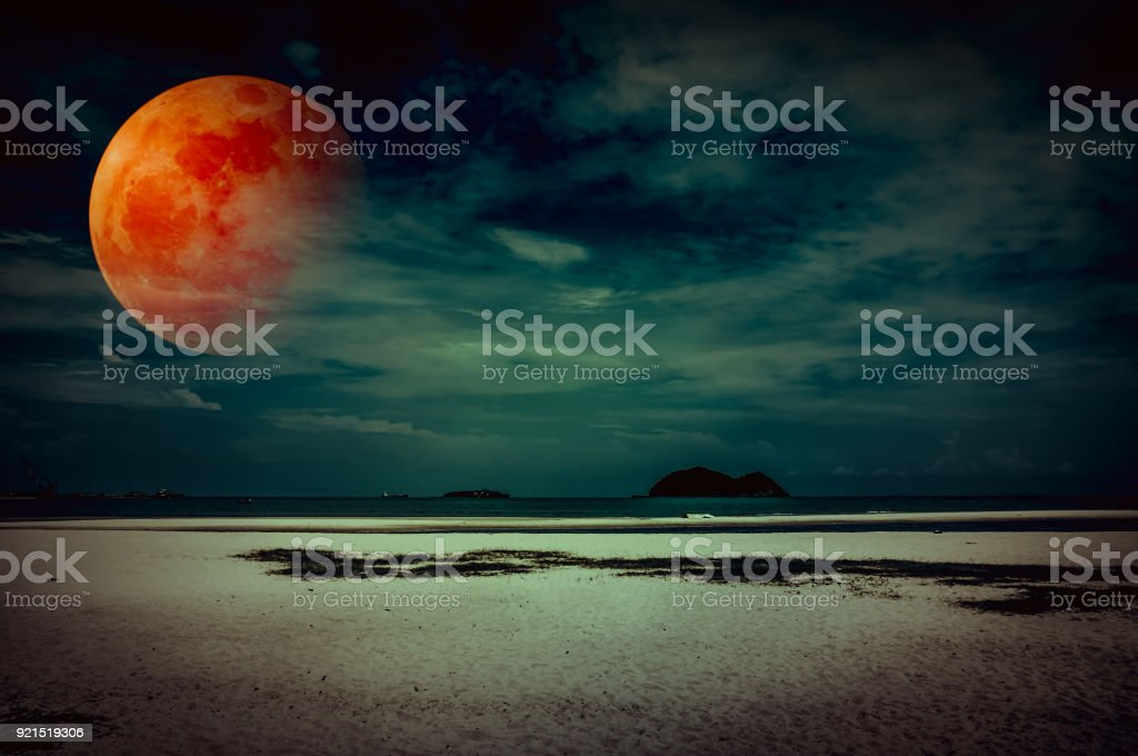 Landscape of sky with bloodmoon on seascape to night. Serenity nature background. stock photo