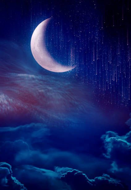 Landscape of sky with crescent, many stars and meteor shower. stock photo