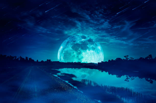 Landscape of sky with supermoon, many stars and meteor shower. stock photo