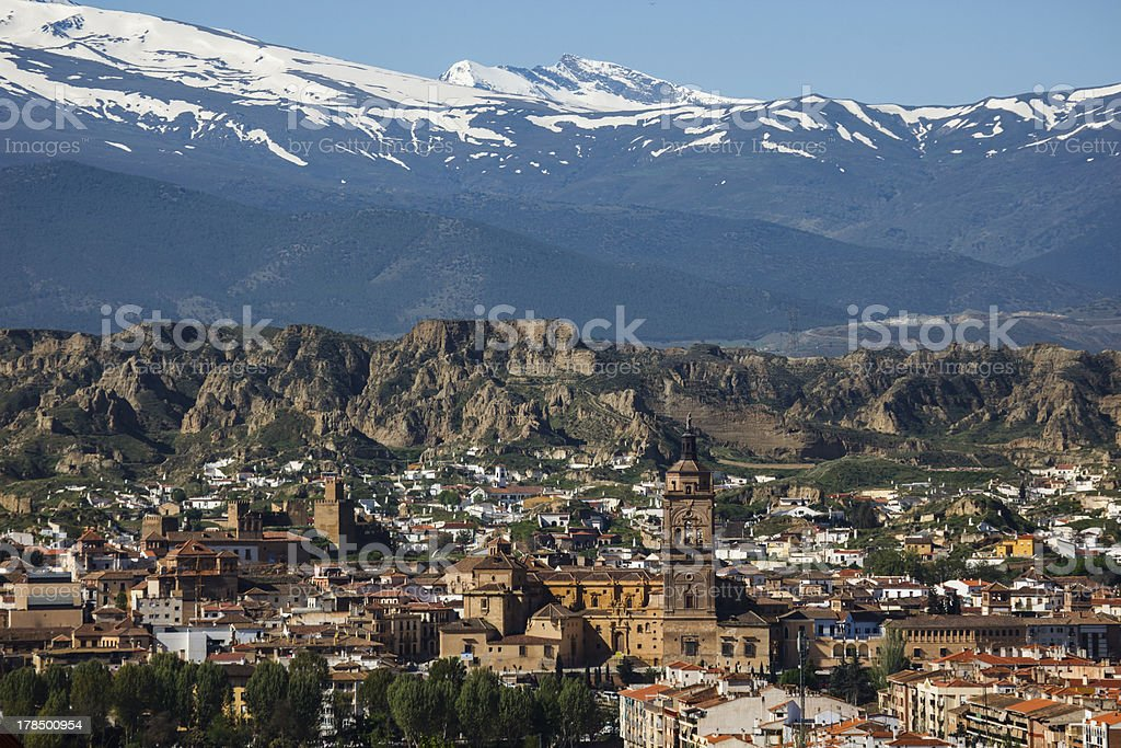 Landscape of Spanish mountain town Guadix before snowcapped Sierra Nevadas stock photo
