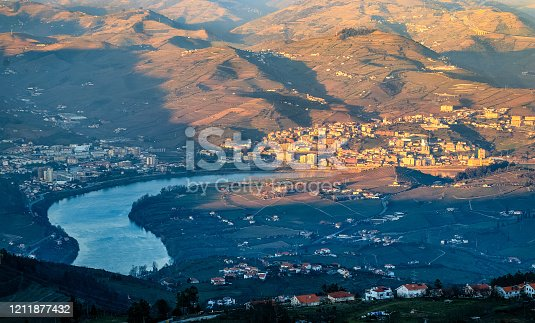 City of Peso da Régua and the Douro River, seen from the Boa Vista viewpoint near Lamego, in Portugal, on a late winter afternoon.