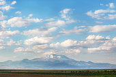 The montain' s name is Erciyes. One of Turkey's most important mountaineering and winter sports centers, Mount Erciyes rises from the south of the Kayseri valley.