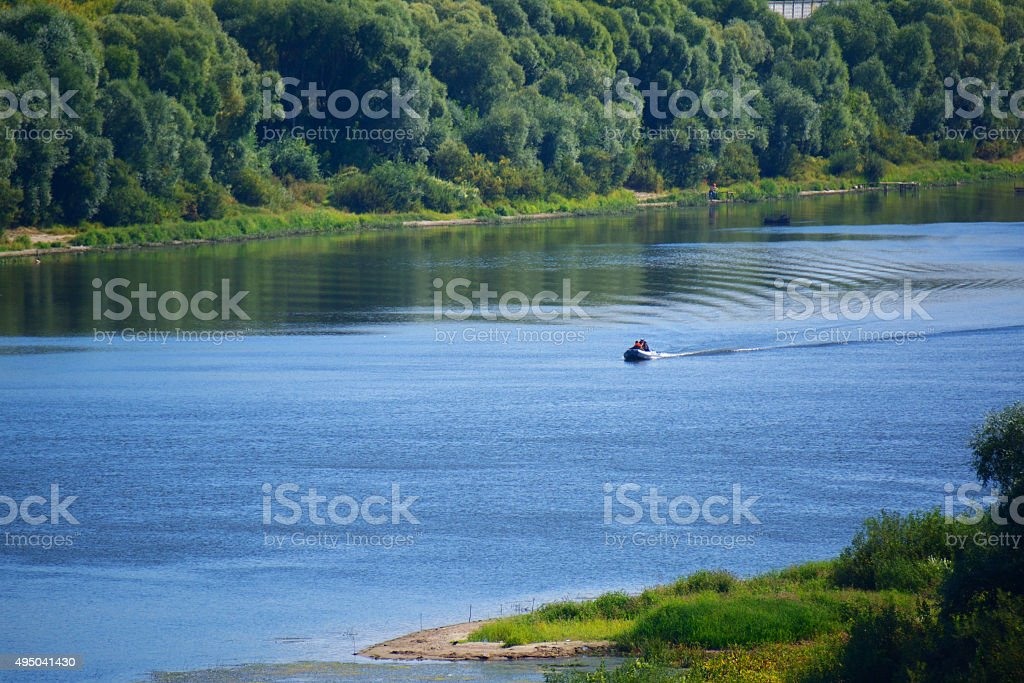 landscape of the river with a boat stock photo