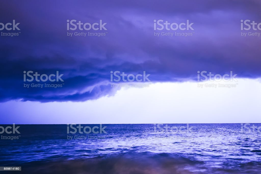 Landscape of Thunderstorm at Night over the Surface of the Water with...