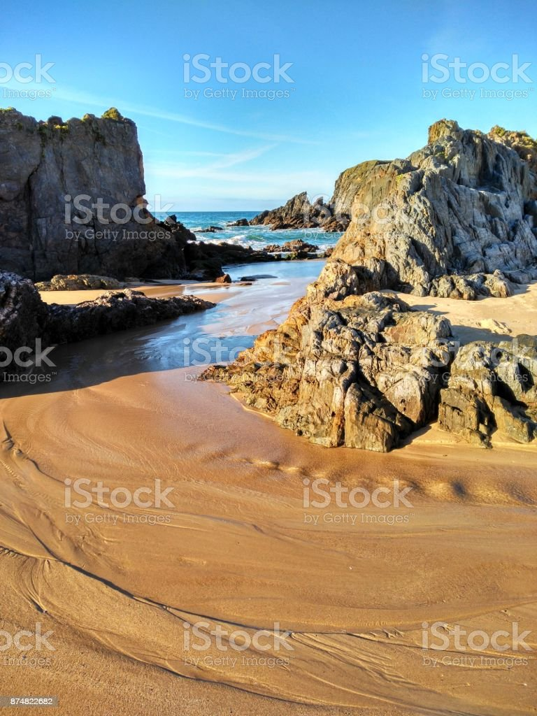 Landscape of white sand beach and cliffs stock photo