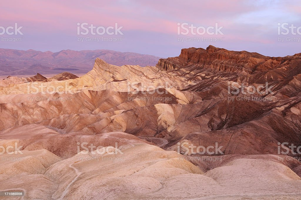 Landscape of Zabriskie point with bright pink sky royalty-free stock photo