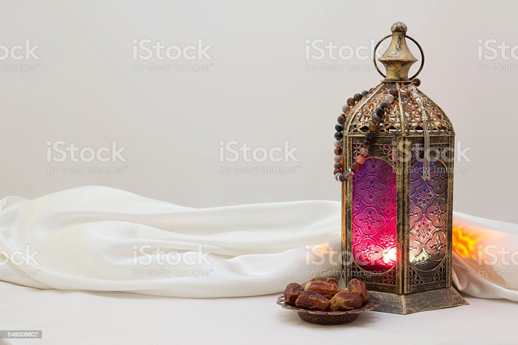 Landscape Photo Of lantern, rosary and Dates stock photo