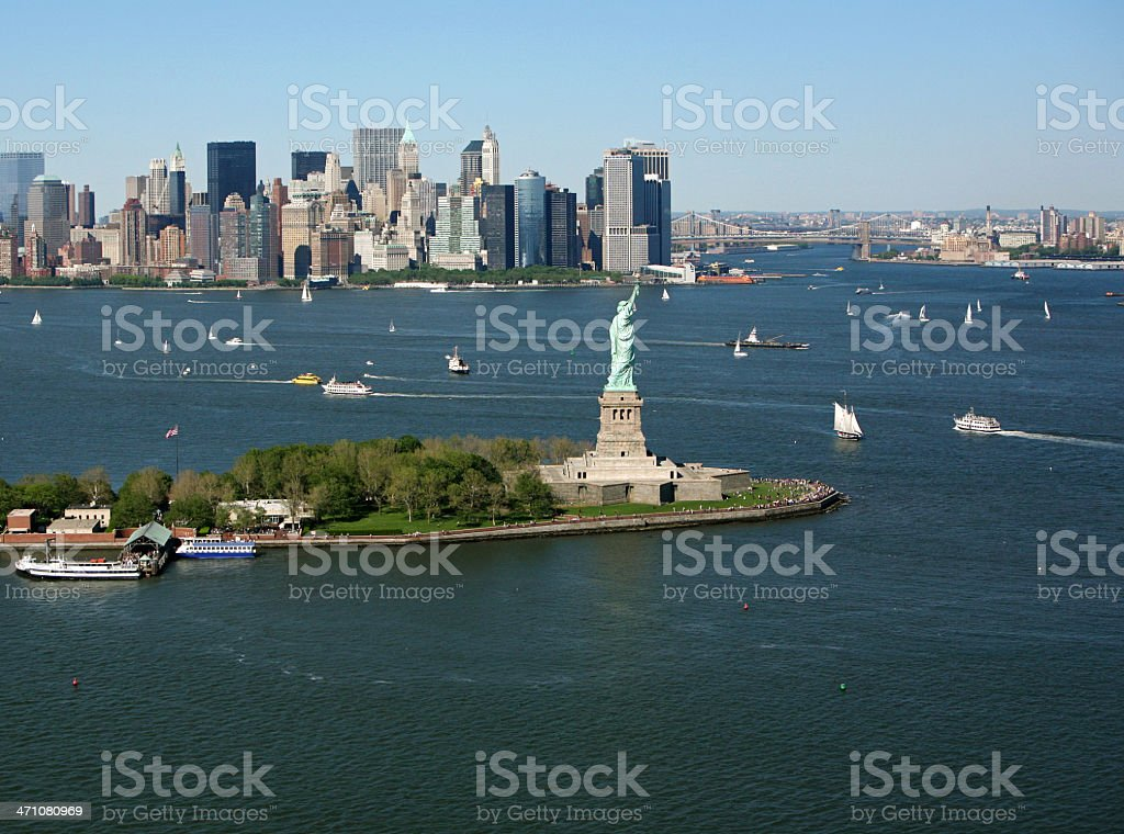 Landscape photo of New York Harbor with boats in background stock photo