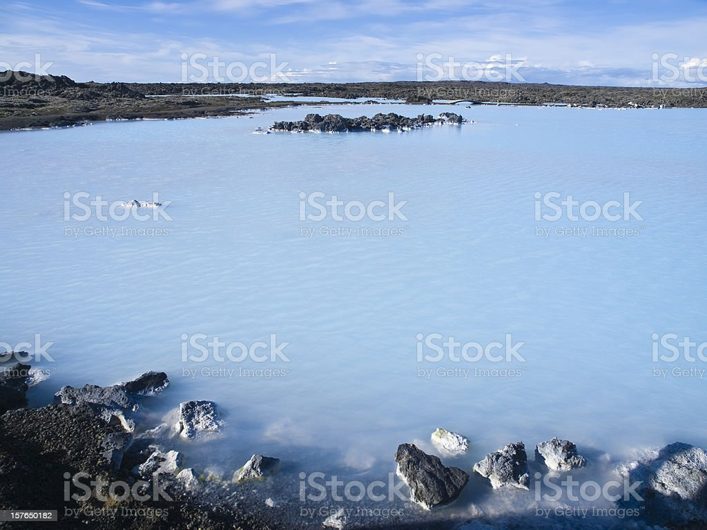 A landscape picture of a blue lagoon royalty-free stock photo