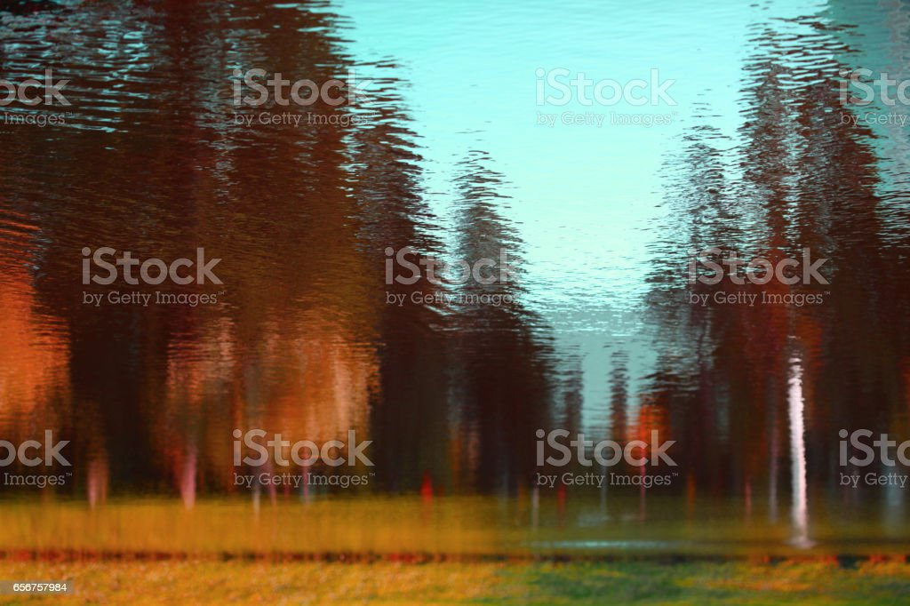 Landscape reflected in water. Abstract nature background. stock photo