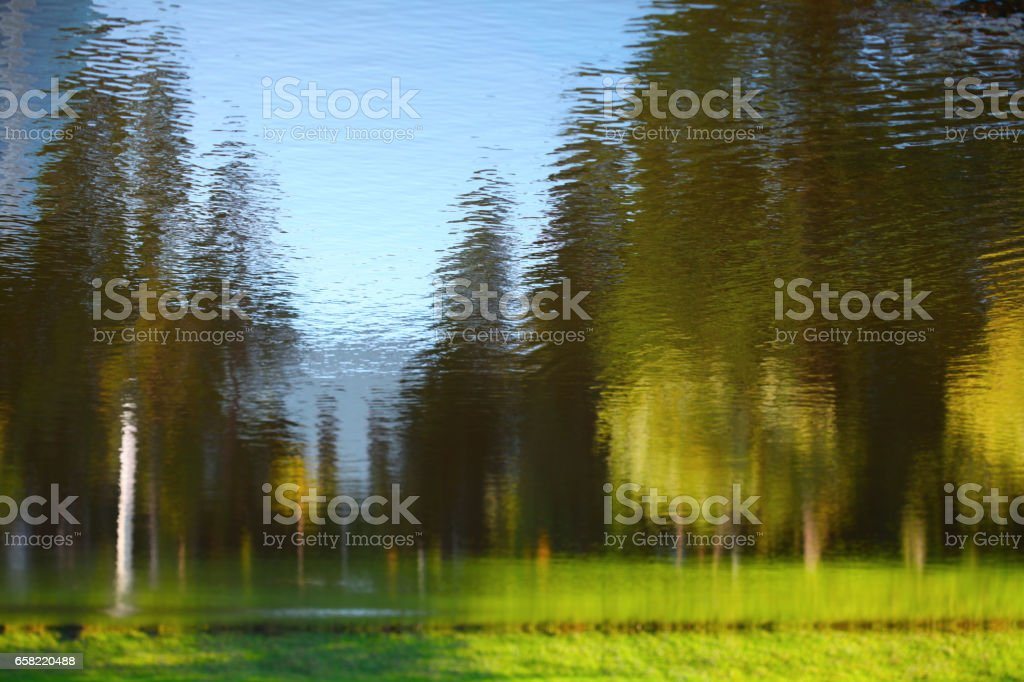 Landscape reflected in water. Nature background. stock photo