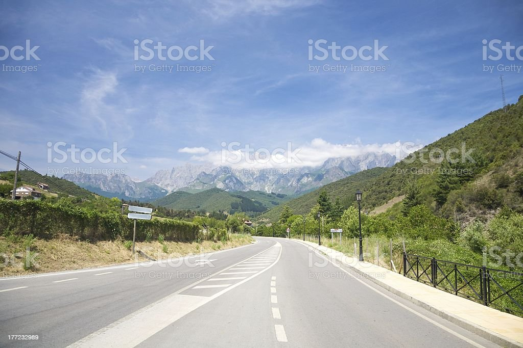landscape rural road to Picos Europa mountains in Cantabria Spain stock photo