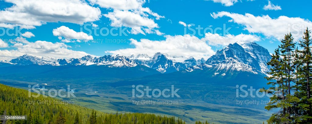Landscape scenic view of heavily forested valley and canadian rocky mountain range stock photo