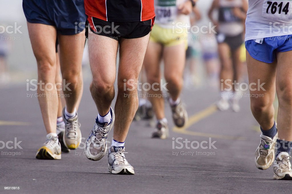 Landscape shot of the legs of marathon runners royalty-free stock photo