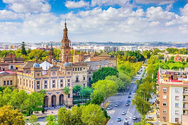 Landscape skyline shot of Seville, Spain in the spring Seville, Spain cityscape towards Plaza de Espana. seville stock pictures, royalty-free photos & images