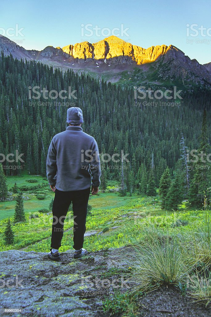 landscape sunrise mountain man looking at view royalty-free stock photo