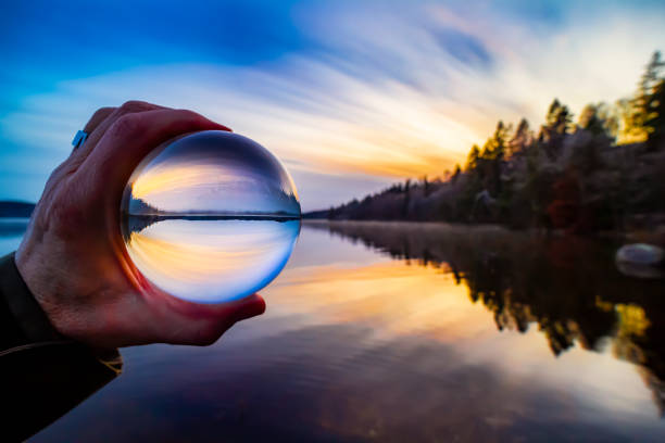 Landscape sunset glassball stock photo