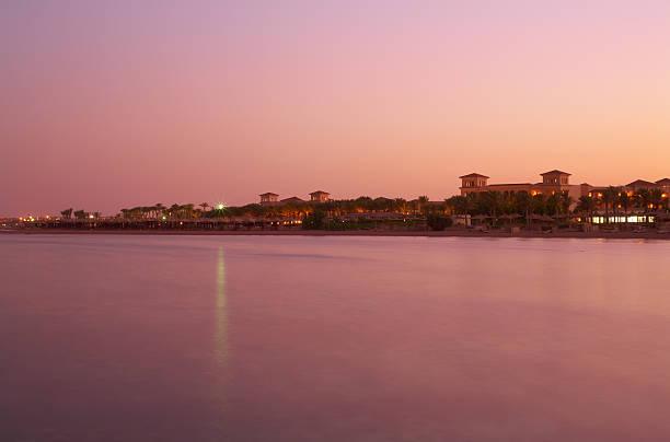Landscape sunset on Red Sea - pink still water, sky stock photo
