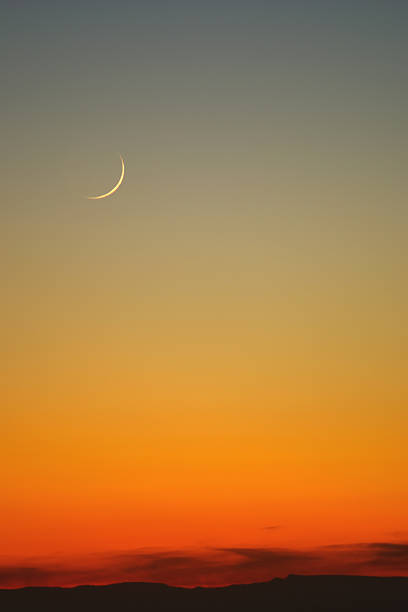 landscape sunset sky sickle moon abstract stock photo