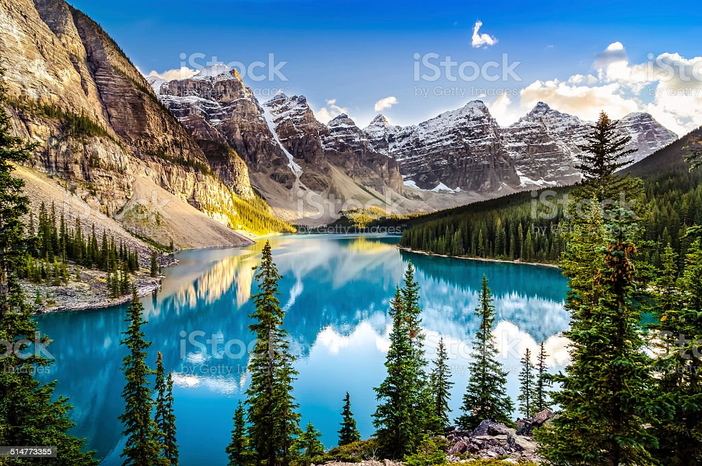 Landscape sunset view of Morain lake and mountain range stock photo