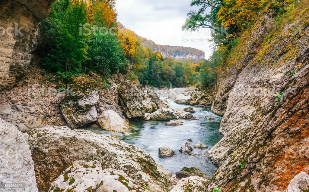 landscape the rocky bed of a mountain river in autumn stock photo