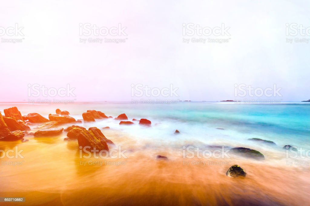 landscape tropical rocky beach background stock photo