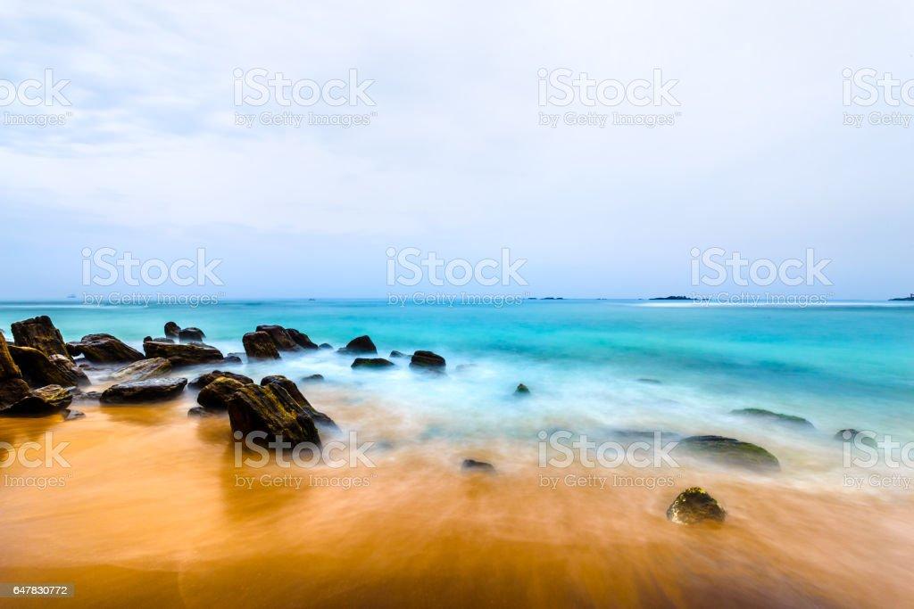 landscape tropical rocky beach stock photo