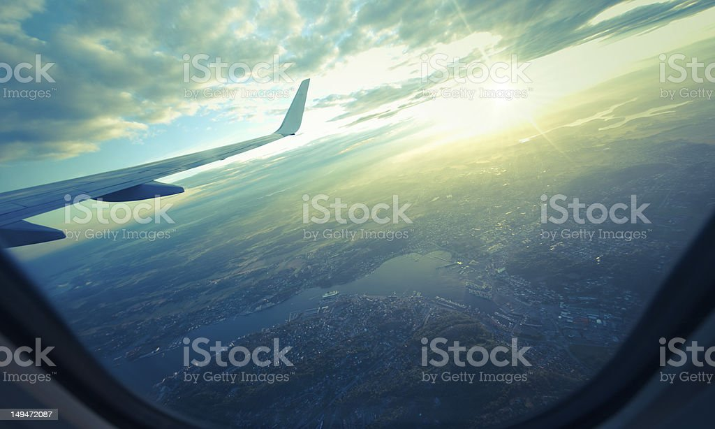 landscape view from airplane porthole on sunset royalty-free stock photo
