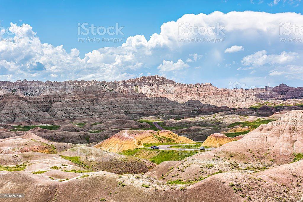 Landscape view of Badlands National Park with curved road stock photo