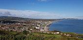 People enjoying living in beautiful landscape full of rock formations along the irish coastline near Killybegs, County Donegal in Ireland.