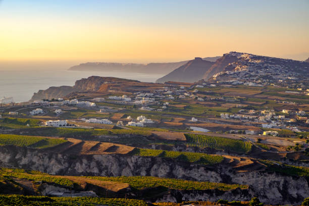 Landscape view of fields, vineyards and greek villages on Santorini stock photo